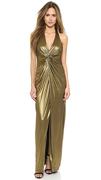 5b449da265c Kim Kardashian catches flight in her VERY revealing golden Grammy ...